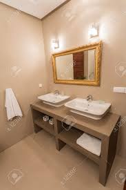 Gold Bathroom Mirror by Mirror With Gold Frame In Luxury Bathroom Stock Photo Picture And