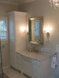 Restoration Hardware Bathroom Cabinet by Margot Hartford Photography Chic White Bathroom Design With White