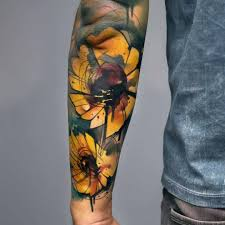 forearm sunflowers tattoo watercolor style flowers tattoo