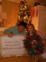 our christmas new years pregnancy announcement the sign reads