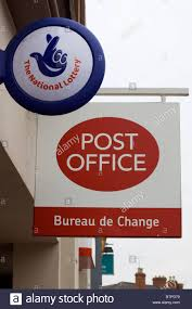 bureau de change nation a post office and national lottery sign outside the post office