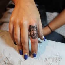 simple black wolf on arm tattoomagz