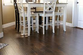 decor walnut wood laminate flooring with white wall and dining