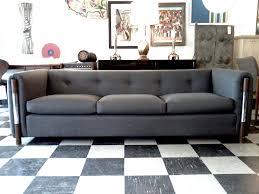 fine grey vinyl tuxedo tufted sofa with nailhead backseat over