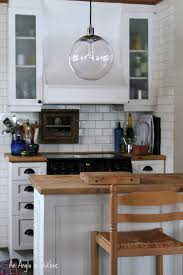 globe pendant light from west elm in a kitchen spotted west elm