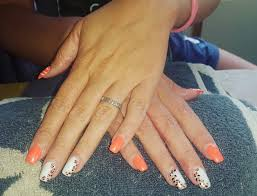 1 weeks growth bright orange and white acrylic nails with leopard