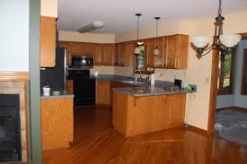 is chalk paint recommended for kitchen cabinets chalk painted kitchen cabinets from honey oak to white