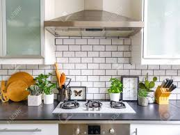 black and white kitchen framed pictures black and white subway tiled kitchen with numerous plants and