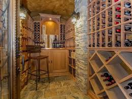 Wine Cellar Wall - mediterranean wine cellar with cathedral ceiling u0026 glass panel