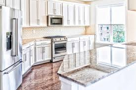 white kitchen cabinets brown countertops brown countertops give this marble a look rsk