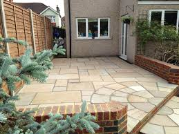 Indian Sandstone Patio by Mw Landscapers Indian Sandstone Patio With Circle Kit Retaining