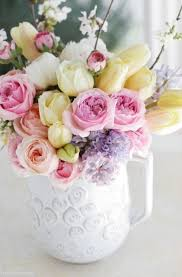 pitcher of roses pitcher of peonies and roses pictures photos and images for
