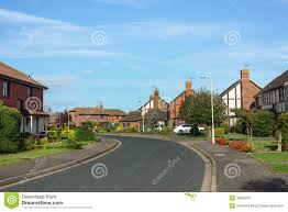 houses on a road in suburbia stock photo image 46600281
