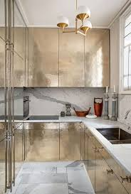 kitchen marble backsplash metal cabinets with golden door colors in the galley kitchen with