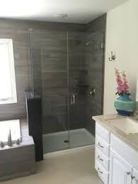 glass barn doors minimalist bathroom with sliding shower