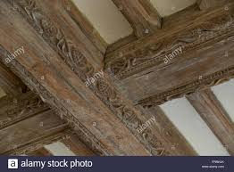carved wood plank decorated wooden roof or ceiling beams oak beams carved wood