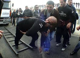 Lasha Pataraia pulls a truck, which weighs 8,250kg (8 tons), with his ear during an event to ... - REU-GEORGIA_-734x540