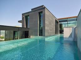 modern swimming pool tiles neutral wooden floor the edge of the