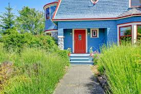 blue entrance porch with contrast red door clapboard siding