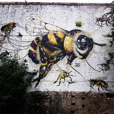a london street artist paints swarms of bees on urban walls to bees 2