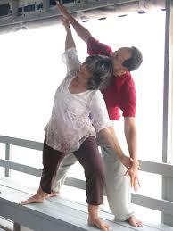 couples yoga yoga on the beach
