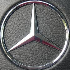 mercedes car emblem closup of mercedes emblem on gear shift car pictures