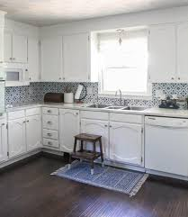 how to paint above kitchen cabinets painting oak cabinets white an amazing transformation