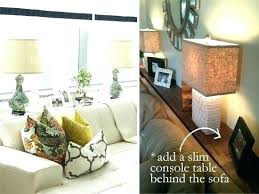 console table behind sofa against wall beautiful shelf behind couch or sofa table against wall 5 decorating
