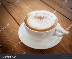 cappuccino cappuccino cup on top old wood stock photo 511778107 shutterstock