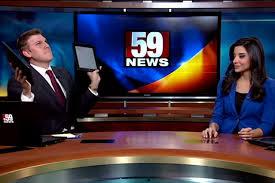 local news anchor dances at his desk