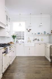 kitchen cabinet shelf brackets a beautiful bright soft grey kitchen with brass handles and taps