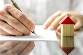 man signing a contract when buying a new house 7th level