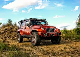 jeep earthroamer rugged ridge custom jeep wrangler review mud covered mango mania