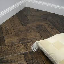 aged herringbone lacquered parquet flooring design in oak or