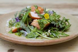 foraged herb salad with smoked salmon and wild garlic dressing