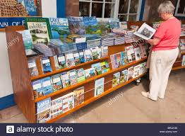 house gift a woman looking at books in the carriage house gift shop store at