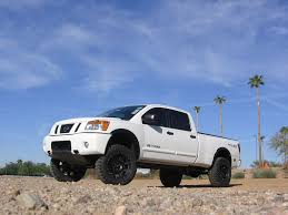 lifted nissan frontier white crew cab longbed check in nissan titan forum