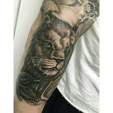 beautiful black and grey lion tattoo by alex feliciano