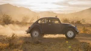 yellow baja bug vw celebrates 50 years of baja i manhandle some buggies in the desert
