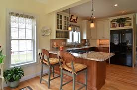 spacius combine small kitchen and sun room to create a spacious