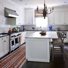 white kitchen island with gray wishbone counter stools