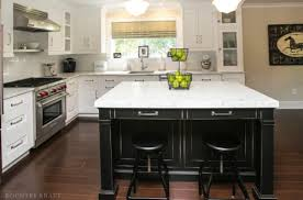 kitchen with black island and white cabinets black kitchen island and white cabinets in chatham nj
