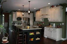hand crafted custom painted kitchen cabinets with stained island