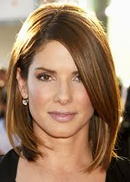 angled hairstyles for medium hair 2013 shoulder length asymmetrical long layered bob with tan angled