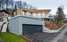Hillside House Plans With Garage Underneath 3 Storey Home On Steep Slope With Grass Roofed Garage