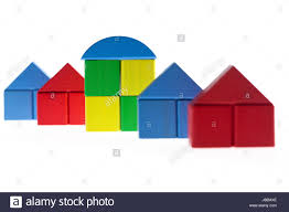 row of plain houses built with wooden toy blocks with one house in