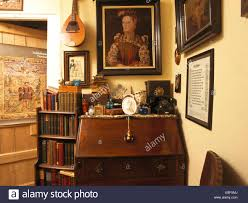 stock bureau small bookcase beside bureau with eclectic collection of objects