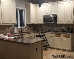 painting my oak kitchen cabinets white from to great a tale of painting oak cabinets
