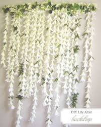diy paper wedding backdrops via brit co paper chip garland oh
