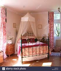 Bedroom Bed In Corner White Voile Mosquito Net Above Brass Bed With Toile De Jouy Cover